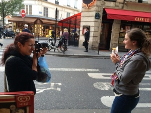Diana taking a picture of Lisa with her crêpe