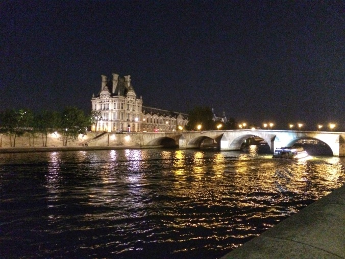 The Seine by the Louvre at night