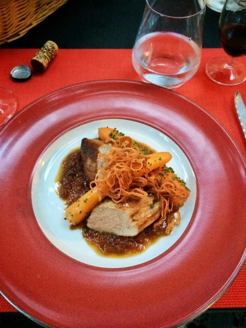 Pork tenderloin with honey and onion sauce, fried onions and garden carrots.