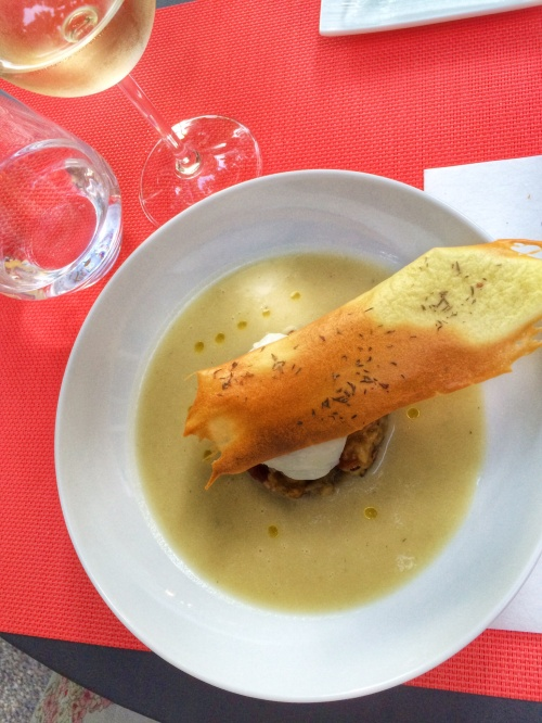 Chilled Eggplant soup with a poached egg and sesame crisp