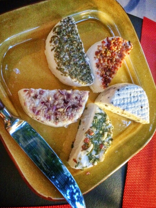 Cheese plate of local chèvre with various herbs and seasonings